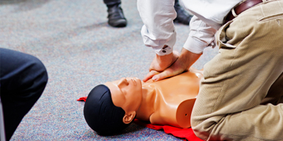 Man issuing CPR to dummy